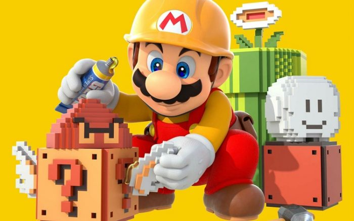 Super Mario Maker: Image features Mario in a yellow, monogrammed construction hat placing 8 bit Mario items