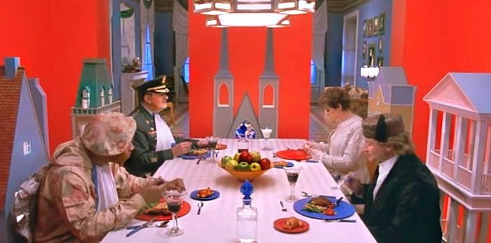 Leslie Zevo, Alsatia, The General and his son Patrick sit down at a table for a colorful meal