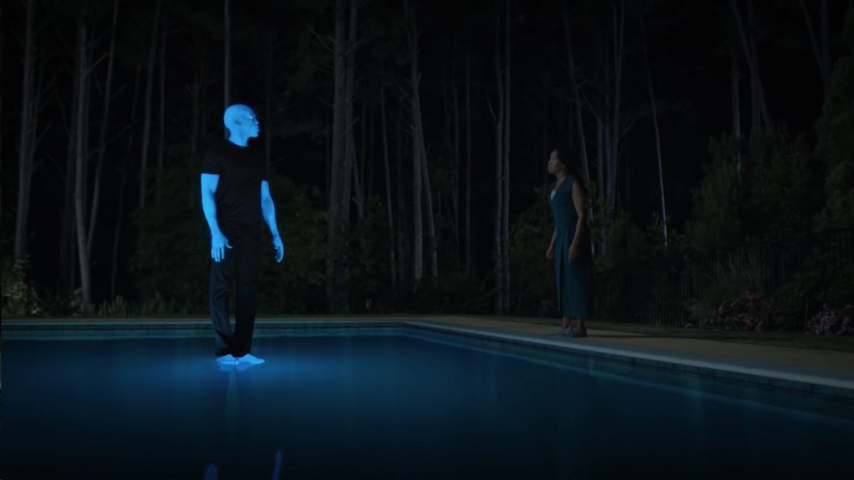 Watchmen - Cal, in glowing blue, is standing on the surface of a pool as Angela talks to him from the sidelines