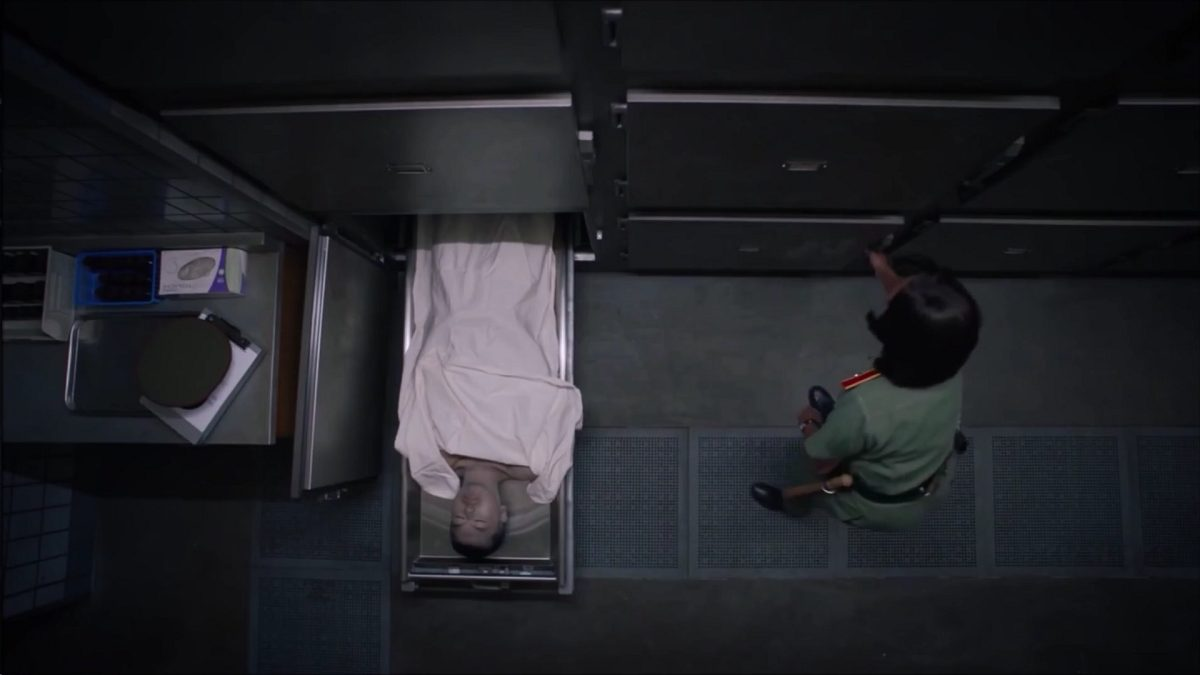 Watchmen - Looking down on a body pulled out of a morgue drawer and Angela reaches for another drawer
