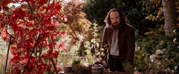 William Shakespeare stands in his garden surrounded by trees