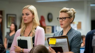 Margot Robbie and Kate McKinnon stand next to each other during Bombshell