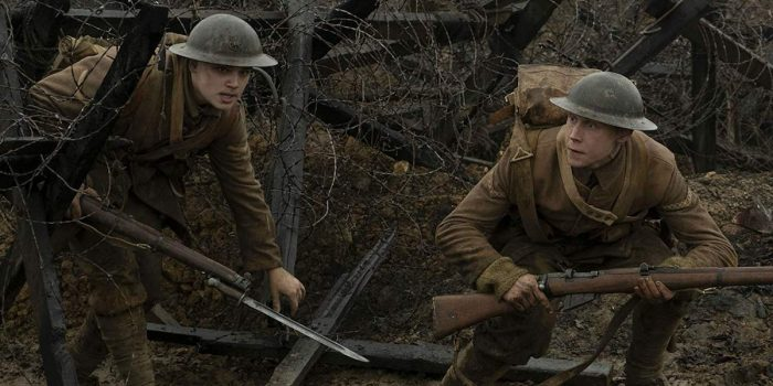 Lance Corporals Blake (left) and Schofield (right) creep through the barbed wire barricades of the battlefield
