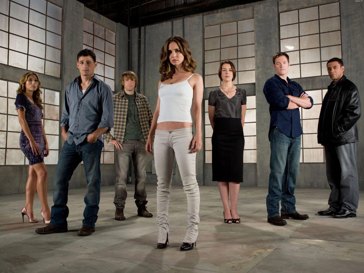 Promo shot of the cast of Dollhouse - Sierra, Victor, Topher, Echo, Adelle, Paul, and Boyd