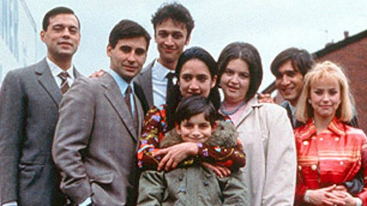 The Khan family stand together on the street