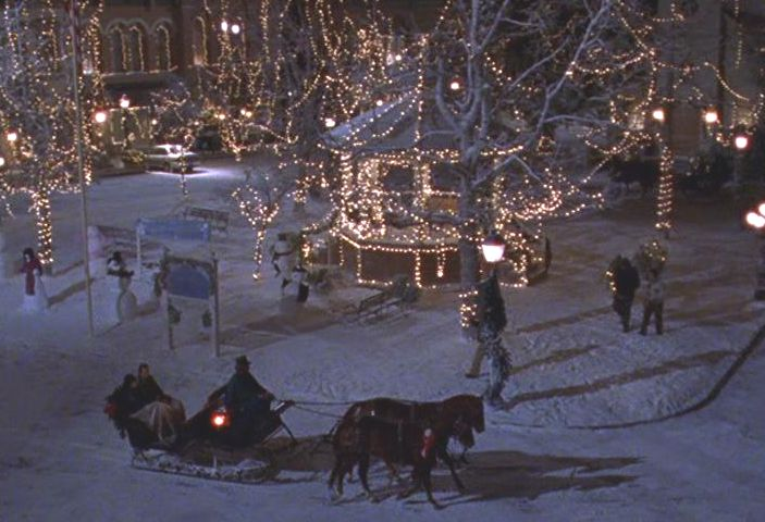 Stars Hollow covered in snow, the gazebo next to a snowman contest and a horse drawn carriage