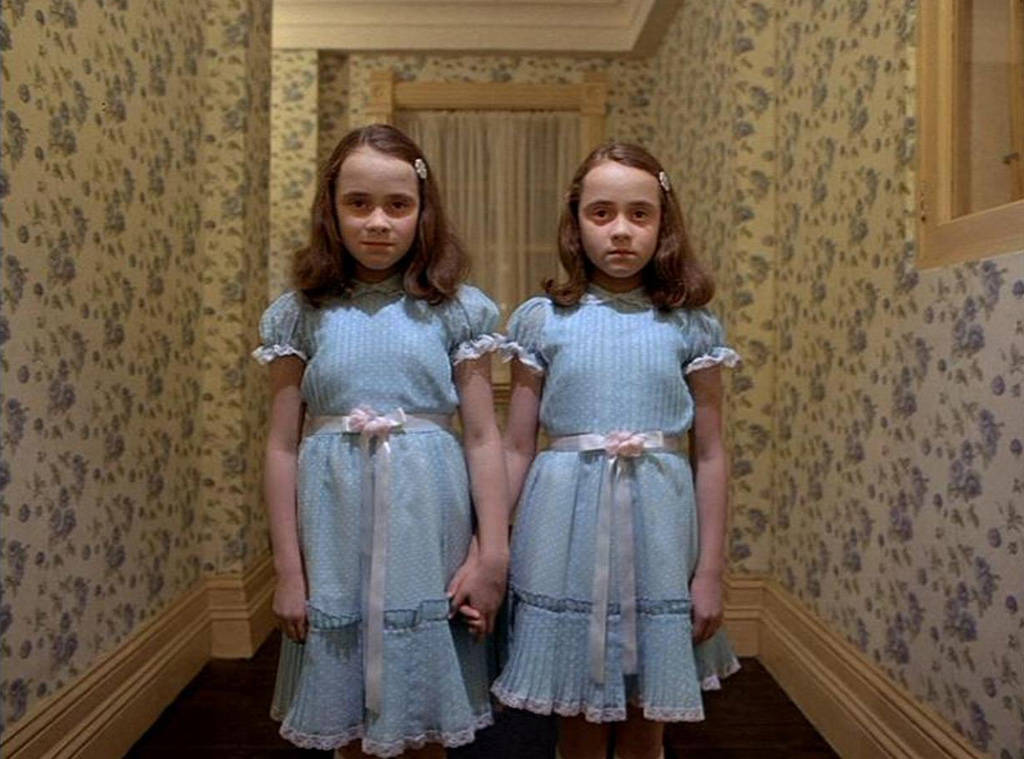 The Grady Twins are two little girls in The Shining stand in a corridor wearing pale blue dresses, hold hands and stare in your direction