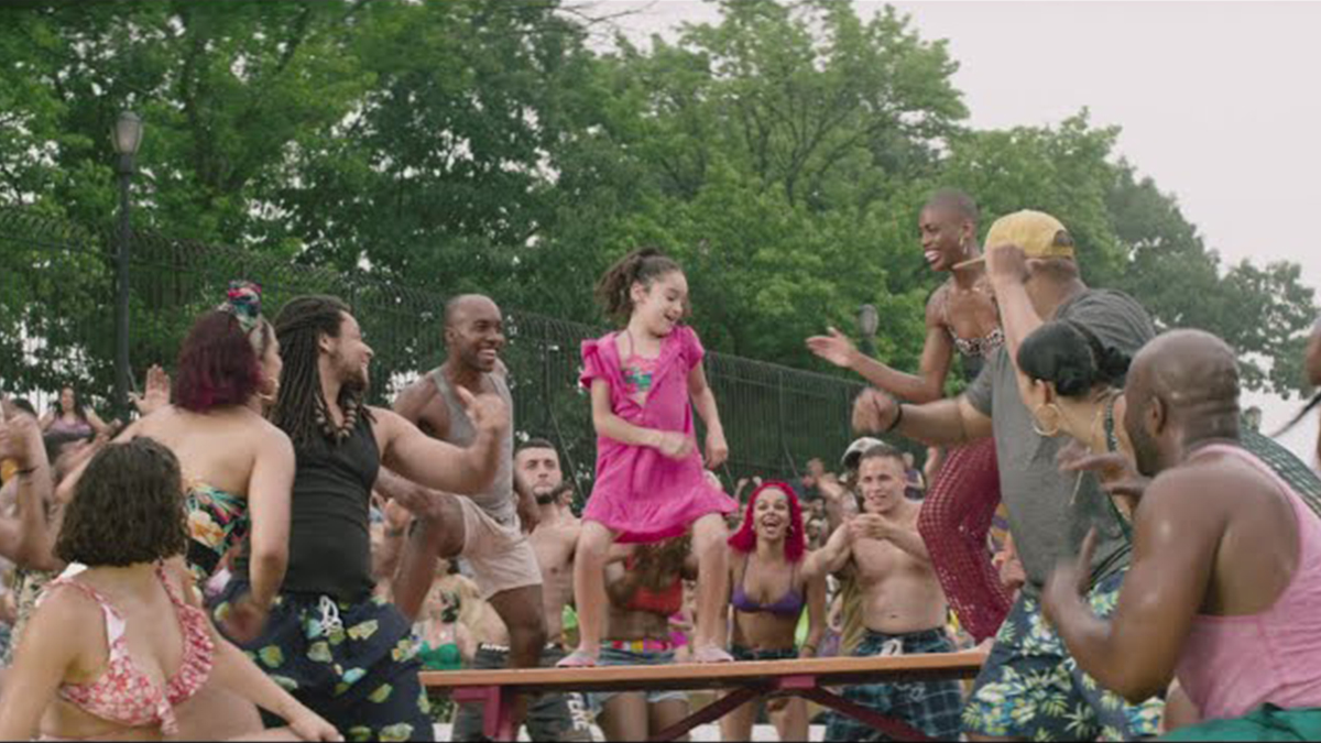 A girl dances on a table in the trailer for In the Heights