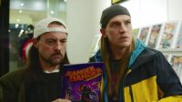 Jay and Silent Bob look at a comic