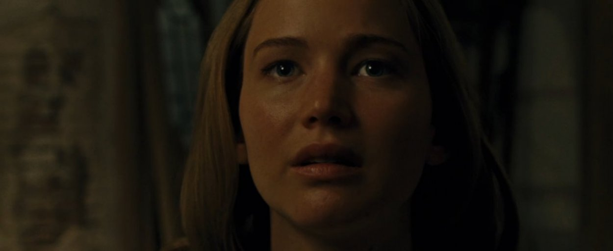 mother (Jennifer Lawrence) makes a facial expression that expresses her distaste