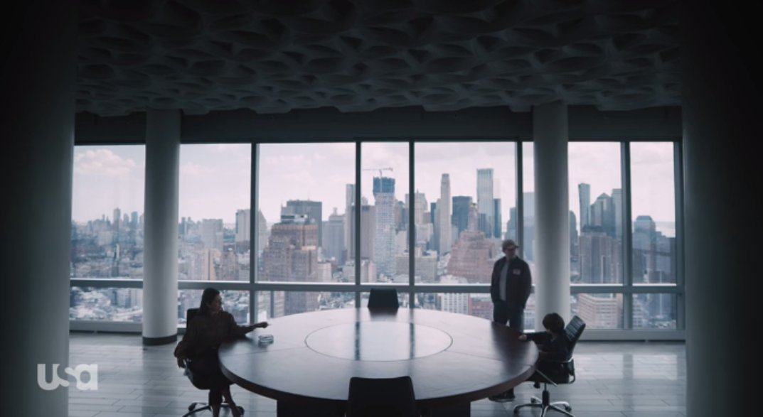 Mr. Robot talks to Magda and the Young Elliot in a boardroom