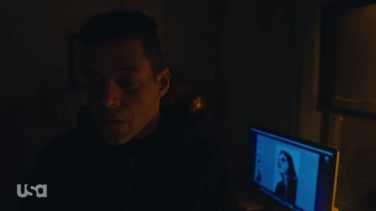 Elliot sits before a computer with an image of himself that has been sketched