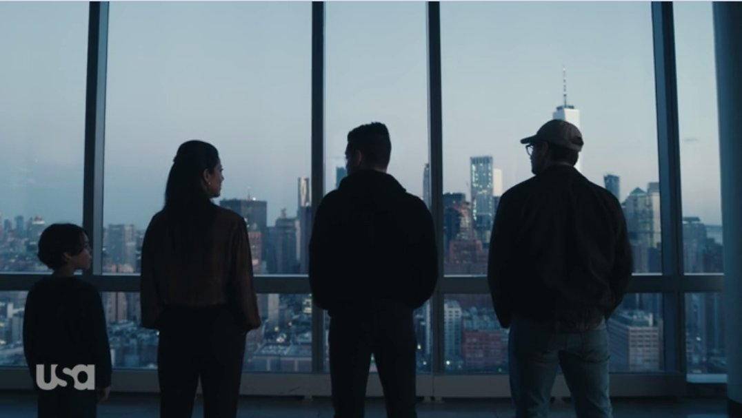 Elliot, Mr. Robot, Magda, and the Young Elliot look out on the NYC skyline