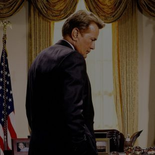 Jed Bartlet standing in the Oval Office