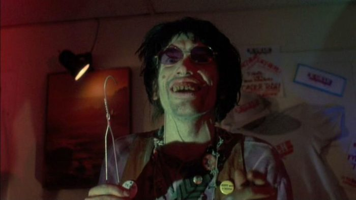 Bill Moseley as Chop-Top holding a wire hanger