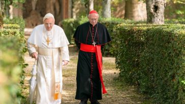 Pope Benedict XVI walks alongside Cardinal Jorge Mario Bergoglio in an outdoor garden