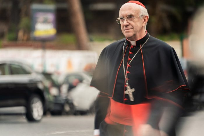 Cardinal Bergoglio waits for a driver to travel to a meeting.