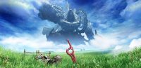 The Monado in a grassy field while the Mechonis looms in the background.