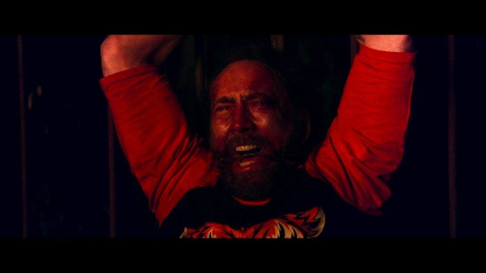 Nic Cage's character in Mandy watches in horror as the titular Mandy is killed. He is gagged and tied at the wrists.