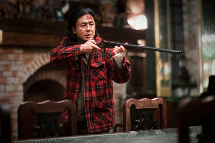 Min- sik Choi's sadistic killer character brandishes a double barreled shotgun at someone off screen