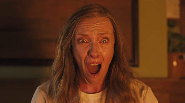 Toni Collette's character stares at something burning off screen wearing a face of pure terror