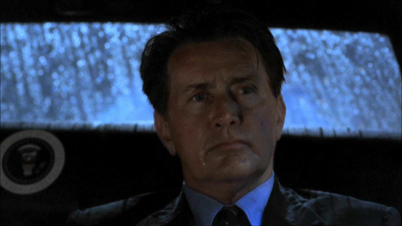 President Bartlet in the back of his limo, on a rainy night