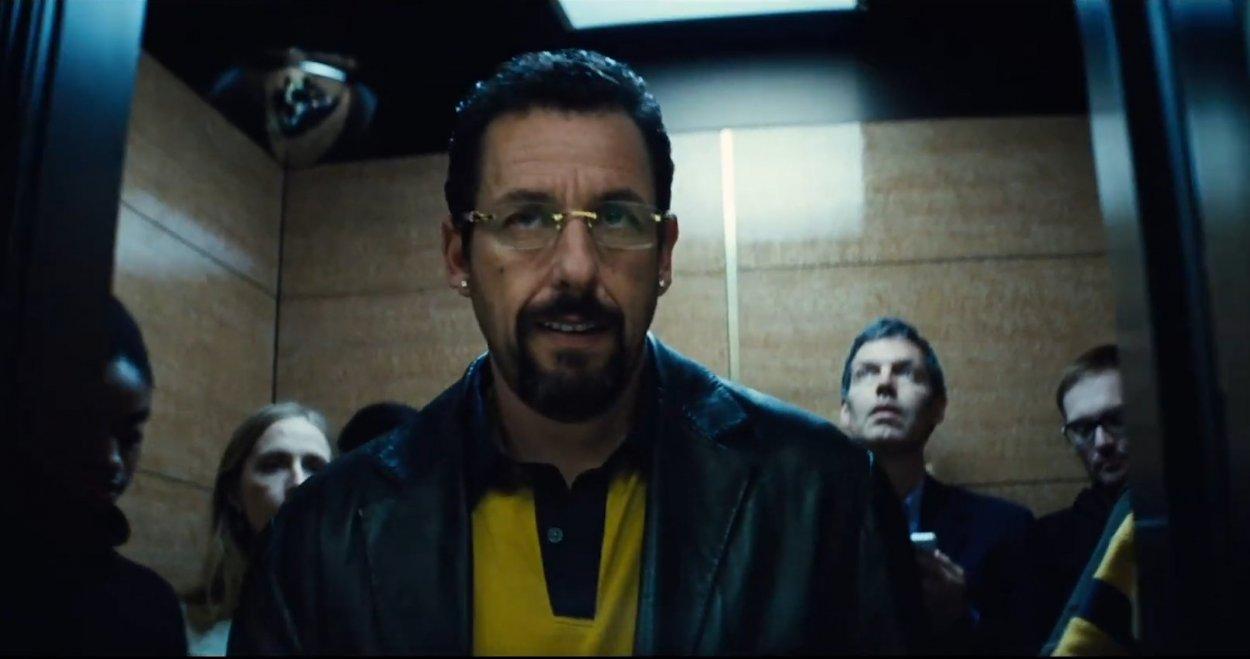 Adam Sandler exits an elevator full of people