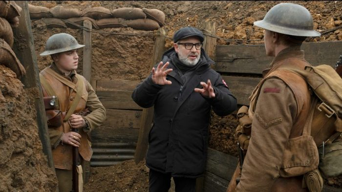Director Sam Mendes gives instructions to two actors in between takes in the trench scenes.