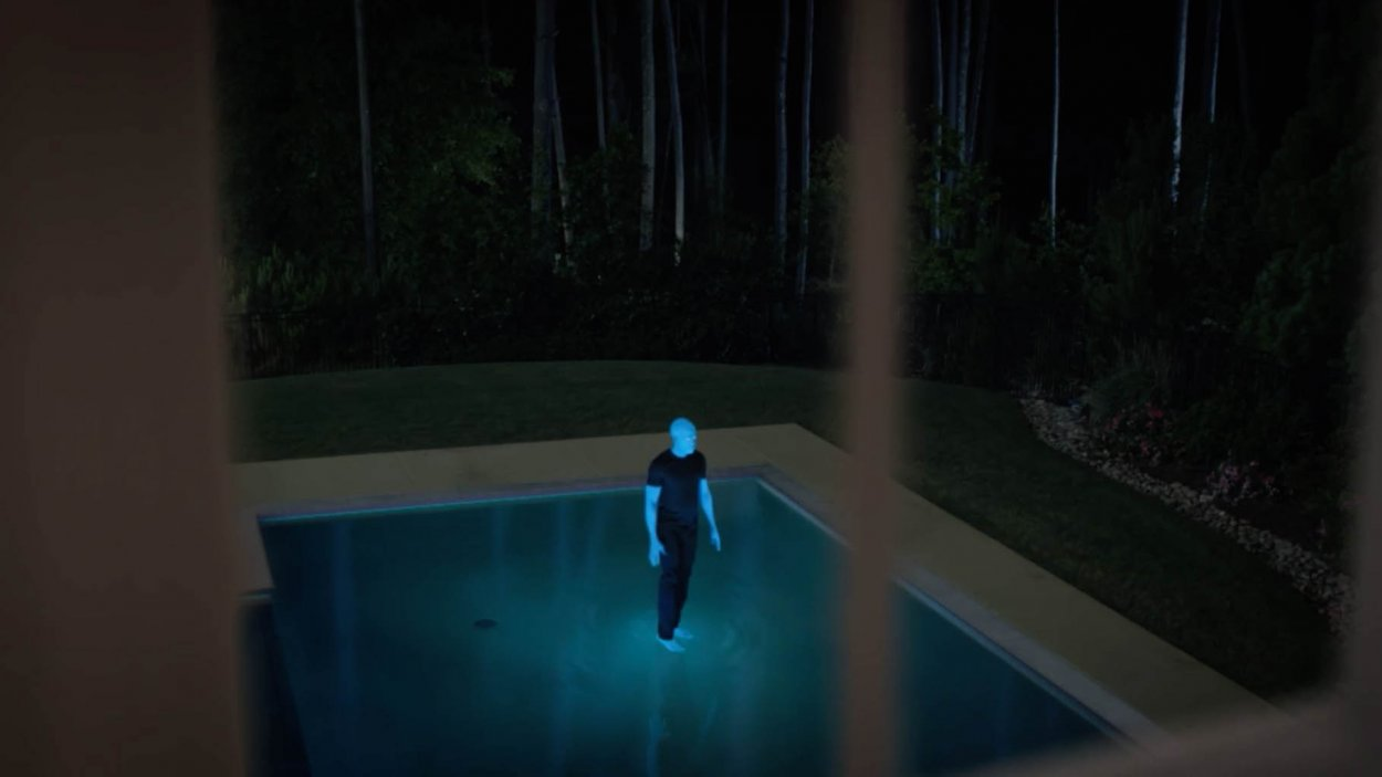 Dr. Manhattan walks on water on his family's pool.