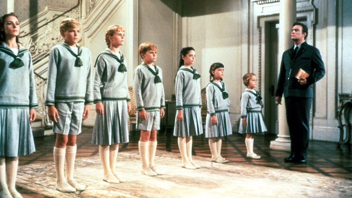 All the Von Trapp kids standing in line to attention