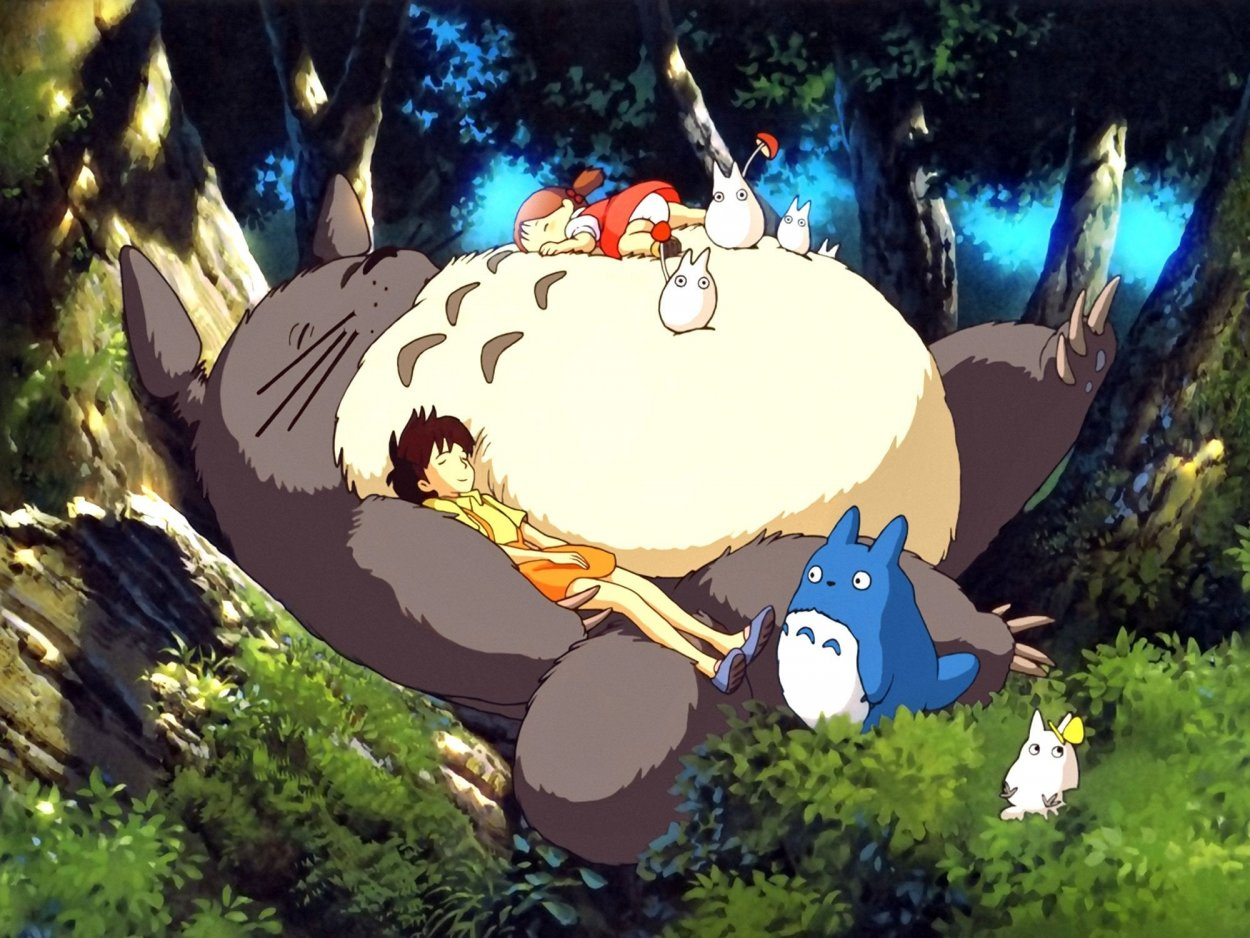 Totoro sleeps in the forest with the two sisters cuddling him, one lying on his belly and one under one arm