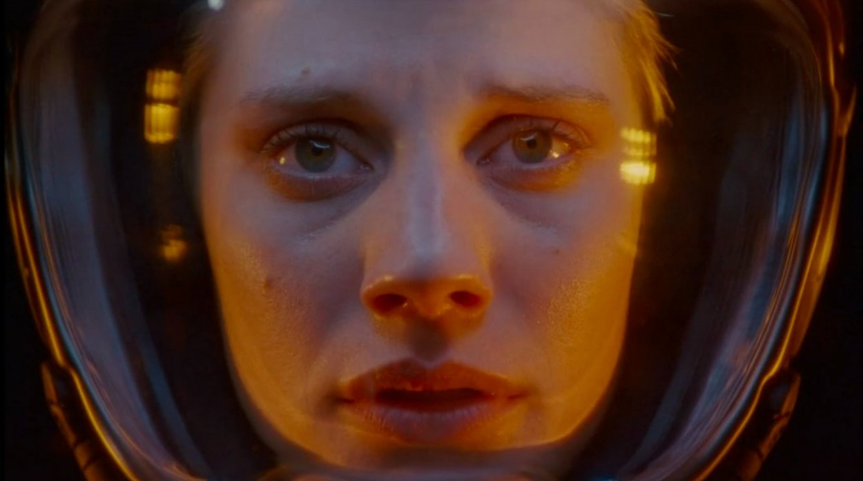 A close-up shot of Starbuck in her flight helmet as she nears a collision with Scar