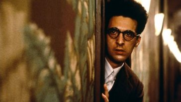 Barton Fink peers from a corner