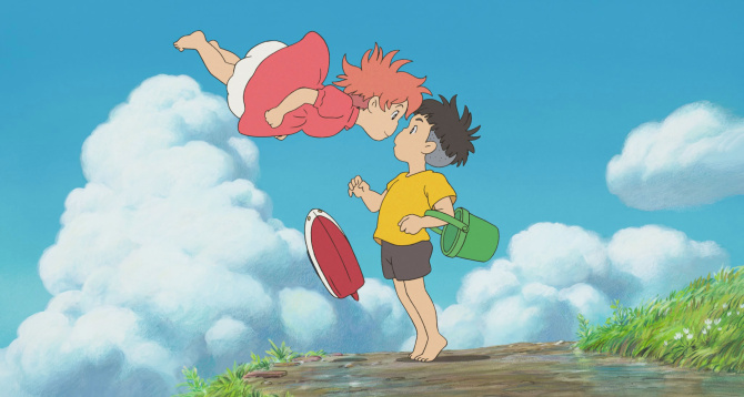 Ponyo balances nose to nose with Sōsuke whilst floating the air