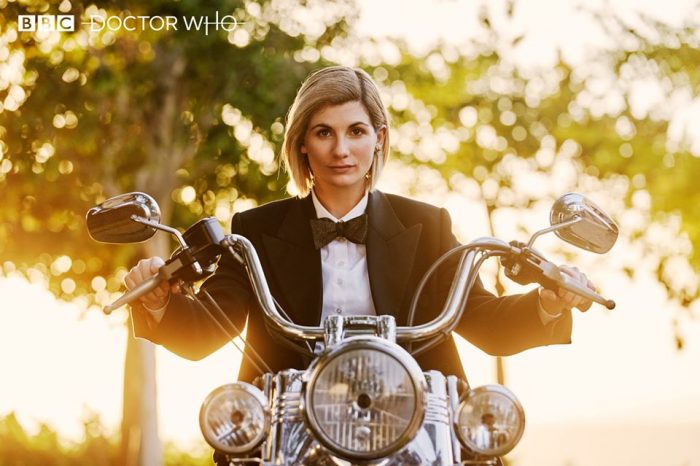 The Thirteenth Doctor (Jodie Whittaker) sits on a motorcycle in Doctor Who's Spyfall.