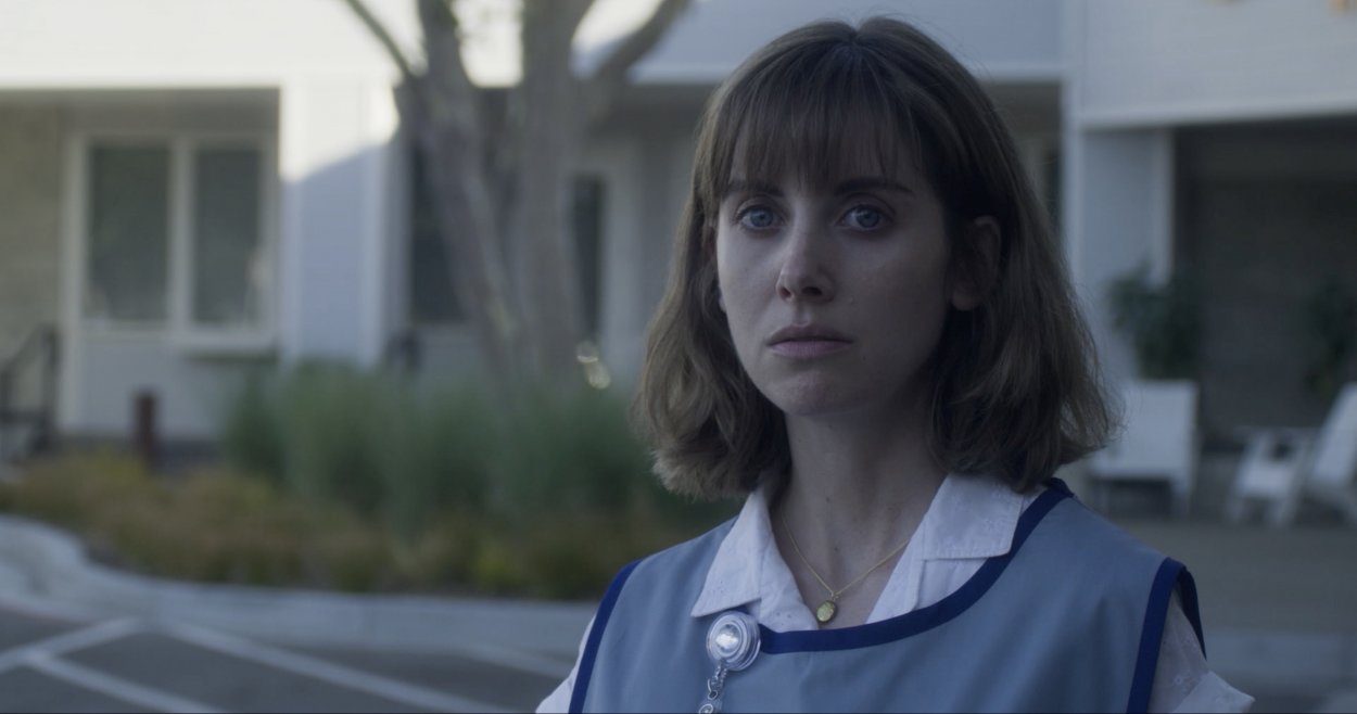 Alison Brie stares at something off screen