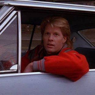 Mike pulls up in his car to speak with Donna