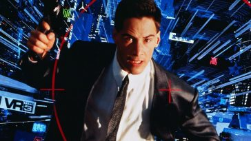 Keanu Reeves holding a gun in the cyberspace world of Johnny Mnemonic