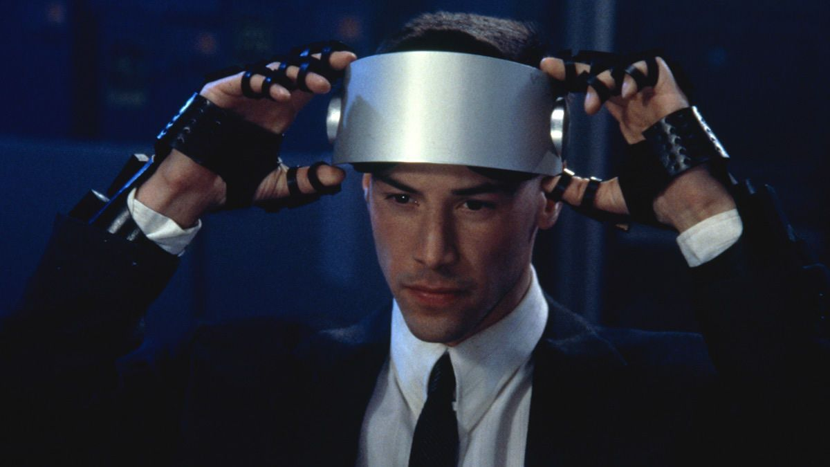Johnny preparing to enter Cyberspace with virtual-reality headset and gloves