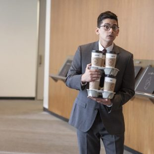 Phil Bisby trying to hold onto several cups of coffee