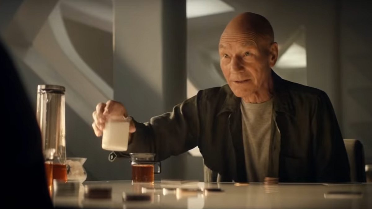 Picard S1E1 - Picard sits at a poker table offerring a cup of milk for tea