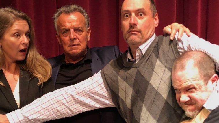 Scott Ryan helps fight off a fan away from Sheryl Lee (Laura Palmer) and Ray Wise (Leland Palmer)
