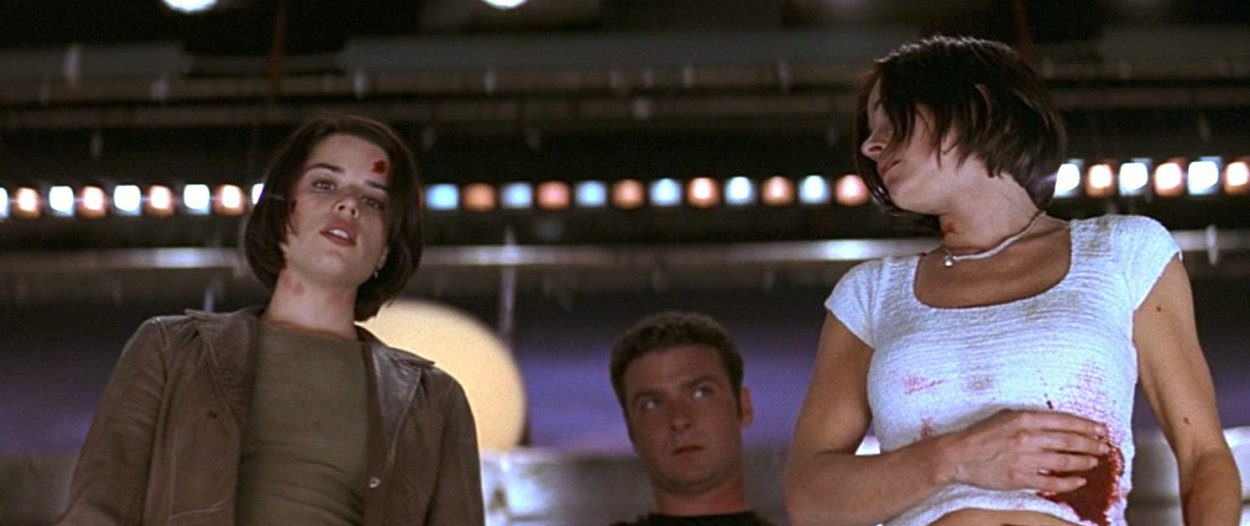 Sidney, Gale and Cotton checking to see if the killer was actually dead in Scream 2.