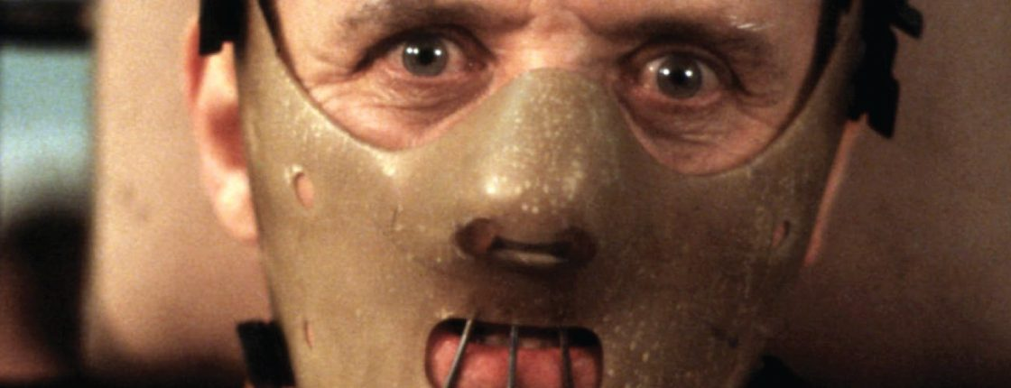 Dr. Lecter being transferred, wearing his face mask that only leaves his eyes uncovered