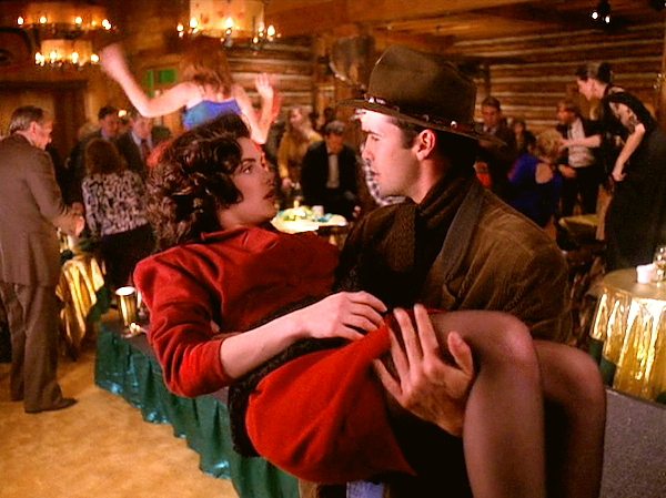 "Audrey Horne falls into the arms of John Justice ""Jack"" Wheeler as the Pine Weasel runs amuck"