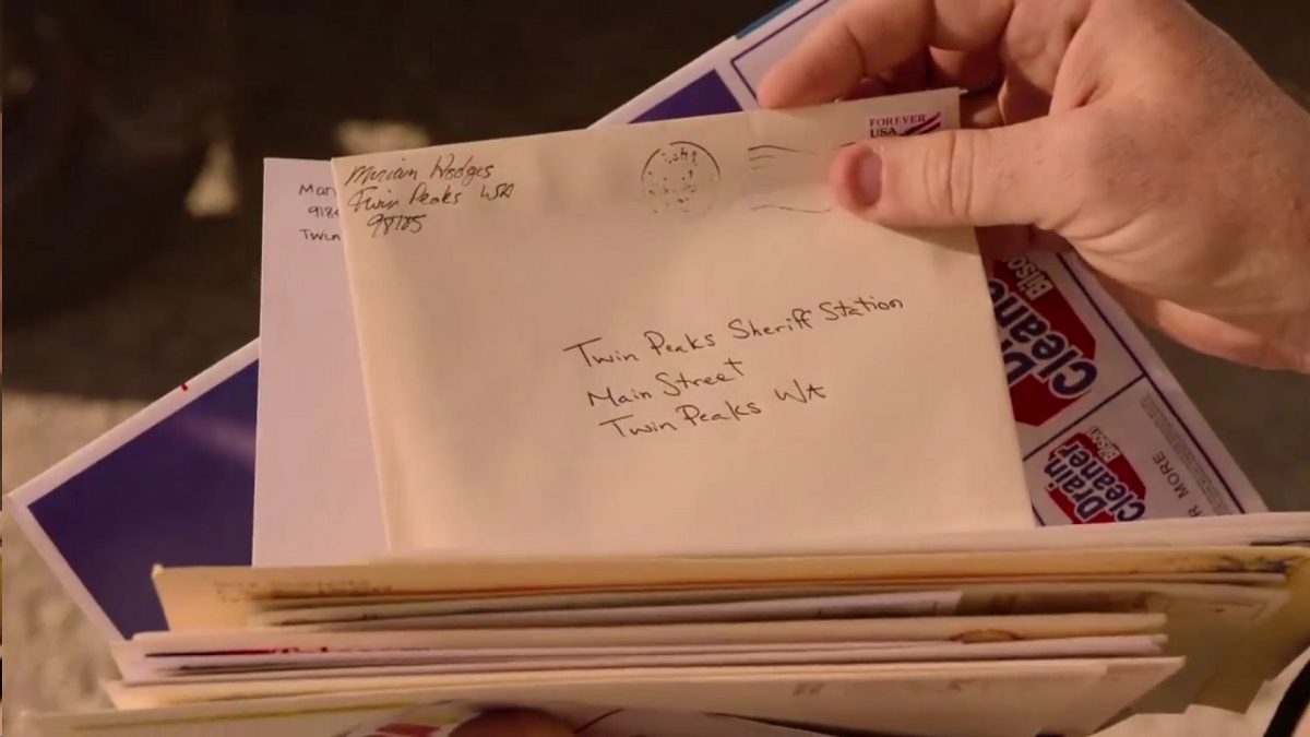 Twin Peaks Part 10 - A hand holds a stack of letters, prominently featuring one from a Miraim Hodges to the Twin Peaks Sheriff Station