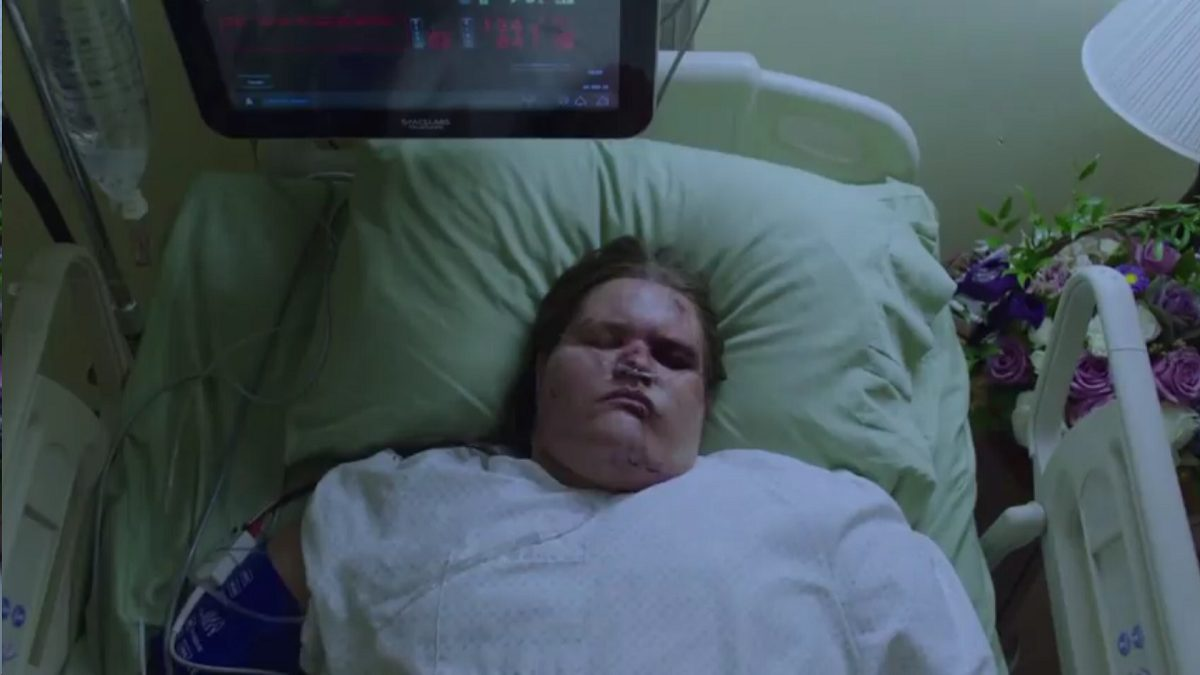 Twin Peaks Part 12 - Overhead view of Miriam lying in a hospital bed with monitor overhead and purple roses beside her bed