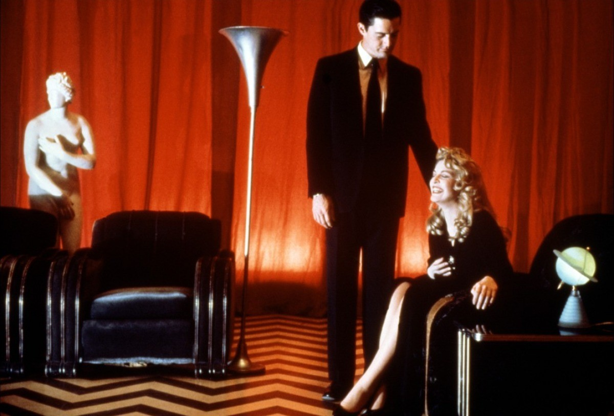 Laura Palmer laughs while Special Agent Dale Cooper watches in Fire Walk With Me.