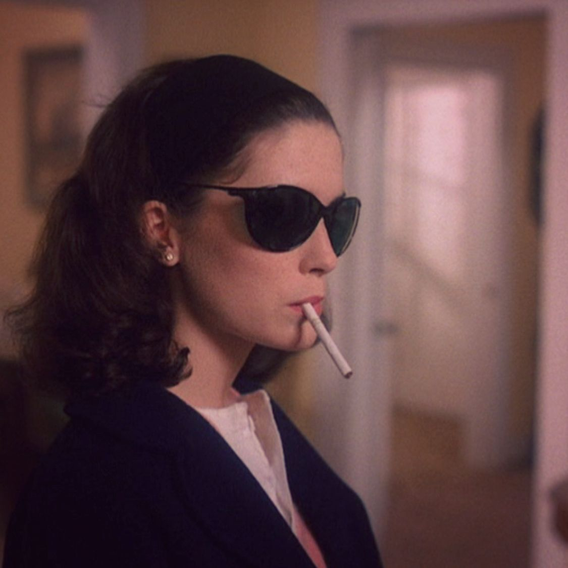 Donna wears Laura's sunglasses while smoking a cigarette in Twin Peaks