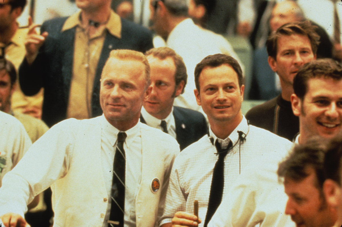Flight director Gene Kranz standing next to fourth crew member Ken Mattingly in a crowd of other workers
